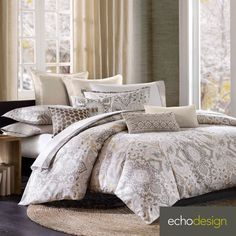 Dress your bed with the calm and casual Echo Odyssey duvet cover. The 100-percent cotton duvet cover features a charming paisley print with brown and ivory tones throughout. Sham is sold separately.