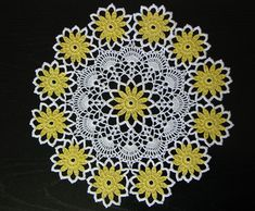 White doily with yellow and black flowers; for a similar doily with roses see Rose Doily.