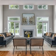 This living or great room is open and bright with everything a home buyer is looking for. Detailed trim work, 10' and double height ceilings, gas fireplace, French door to the exterior, recessed lights, wide plank hardwood flooring and a neutral color palette. Listed in Vienna, VA for $1,599,999 by The Casey Samson Team, a Wall Street Journal Top Team in Northern Virginia.