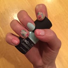 Aww I did my wedding/Easter mani!! I needed something with pink and mint green for my friends wedding but I wanted florals and spring like nails too for Easter and I think I totally nailed it!! I absolutely love this mani and it may be my newest favorite one!! I can't stop staring at them!! what do you think?! #mani #manicure #jamberry #favoritemani #jamberrynails #igetpaidtohaveprettynails #andsocanyou #sweetsurprisejn #freshjn #sorbetjn #spring #nails #easter
