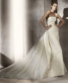 Prologo sheath lace wedding dress with a dramatic train.