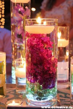 decorating idea candlesticks filled with water and are within natural flowers