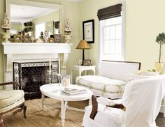 I like the white and green tones in this cozy sitting room.