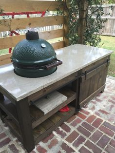 The perfect Big Green Egg table with concrete top, barn door, and built-in lights.