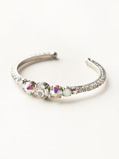 This cuff bracelet is pretty and petite yet packed with sparkle! Multi-sized round crystals cover this bracelet from end to end. Add this beauty to your current arm party or wear alone for a subtle statement. All Sorrelli jewelry is covered by our exclusive Lifetime Warranty!