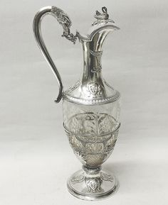 A stunning quality 19th century cut crystal claret jug with decorative silver mount and pedestal foot. Very elegant design. Original gilt inside the lid. The jug has a silver swan finial and a graceful curving swan design handle. There are additional swan themes within the pierced silver body decoration. The crystal glass body has excellent quality deep cut designs and heavy crisscross work. Contains 690 ml. Height 32.5 cms. Spread 13.5 cms. Marked around the top silver mount with French…
