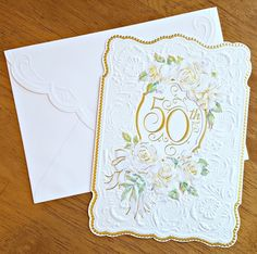 """Card - 50th Anniversary Die-cut, embossed card with coordinating envelope Measures approx. 5.5"""" x 7.5"""" Interior Message: """"Happy 50th Anniversary"""""""