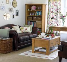 Consideration of Interior Design Ideas for Living Rooms: Awesome Interior Designs For Small Living Rooms With Comfortable Black Loveseats And Cushions Also Wicker Basket Along With Wooden Coffee Table On White Rug And Floral Pattern Curtain ~ promwardrobe.com Interior Design Inspiration