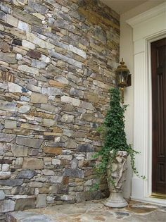 A colorful stacked stone entryway by European Stone Masonry LLC