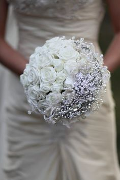 I like the way the broaches are in a crescent shape on the side. It reminds me of the moon. Jeweled wedding bouquet.