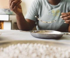 One of our amazing artisans in Haiti, creating our Willow Necklace!  We are empowering women out of poverty while creating entrepreneurial opportunity for the modern American woman. Shop our products & join our team.