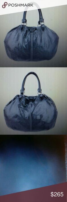 """MIU MIU Black Textured Leather Satchel Black leather Miu Miu satchel with detachable flat shoulder strap, dual roll top handles, grey contrast stitching. Single zip interior wall pocket and magnetic top closure. Gently loved!   All reasonable offers considered.  Generic dust bag included Thanks!  Measurements Shoulder strap 18"""", Height 18"""", Width 15"""" depth 4"""" handle drop 6.5"""" Miu Miu Bags Satchels"""