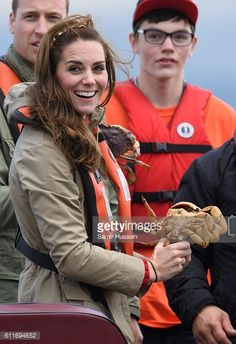 Prince William Duke of Cambridge and Catherine Duchess of Cambridge hold a grab on a fishing boat trip on September 30 2016 in Haida Gwaii Canada