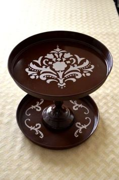 Ok, so I've seen tons of these hand-made stands using candlesticks, etc. But I like that she used burner covers from the dollar store (great idea) and I like the stencils.