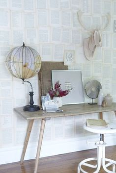 Wall covered with pages from a page.....Gorgeous! desk
