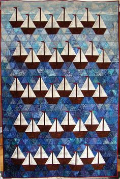 """Sailutations"", based on a Sara Nephew pattern.  People signed the sails at a reception.  (At first, I wanted to call it ""Rows, Rows, Rows of Boats"")"