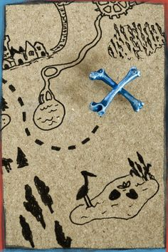 Secrets to uncover? Dangers to avoid? You decide. Crossed bones of silver, for your ears only. X Marks the Spot Earrings.
