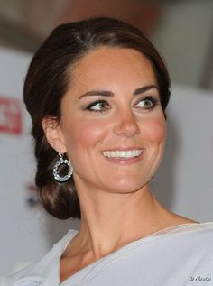 Kate Middleton had her hair in a chignon with nude lipstick and heavy eyeliner
