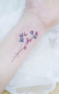 Discreet And Charming Wrist Tattoos You'll Want To Have – foot tattoos for women flowers Purple Flower Tattoos, Tattoos For Women Flowers, Wrist Tattoos For Women, Flower Wrist Tattoos, Small Wrist Tattoos, Bee Tattoo, Tattoo You, Classy Tattoos For Women, Baby Tattoos