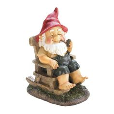 August Grove Ol grandpa gnome is rocking his cares away on a green patch of grass. This adorable Rocking Chair Gnome Statue has a red hat, overalls, and a pipe in his mouth. He will love spending his time on your porch or in your garden. Gnome Garden, Lawn And Garden, Garden Gate, Garden Fun, Garden Crafts, Diy Crafts, Dyi, Outdoor Garden Statues, Gnome Statues