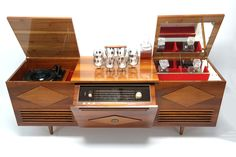 The famous Koronette stereo console with built in bar.  https://www.pinterest.com/0bvuc9ca1gm03at/ Vintage Stereo Cabinet, Record Cabinet, Bar Console, Console Cabinet, Record Player Console, Record Players, Mid Century Decor, Mid Century House, Mid Century Furniture