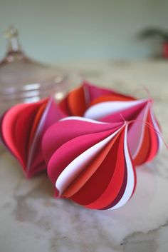 pink and red paper ornaments. love.
