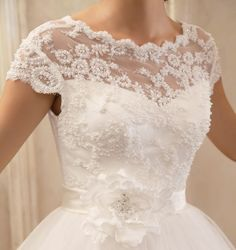 Vintage Inspired Wedding Dress Vintage Lace Cap Sleeve Top Custom Sizing Available. $299.99, via Etsy.