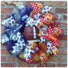 House divided wreath! Baltimore Ravens & Kansas City Chiefs football wreath. More wreaths can be found on my Facebook page: www.facebook.com/CraftsandCreationsByTerri or go to my Etsy page https://www.etsy.com/shop/CreatedByTerri