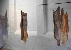 "Pat Loucks ""Skin Deep"" 2013 Installation view at Galeria de Exposicoes Temporarias do Castelo de Portalegre. Re-purposed cotton fabrics torn, slashed, re-constructed, earth pigments, stitching, applique. Photo by Pat Loucks"