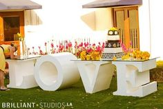 I adore this amazing cake table with the table made from the word LOVE. So cool!