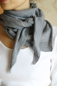 Grey Scarf  (love how she tied it) over a white scoop-neck shirt