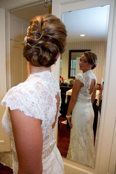 we love this brides hair! ... and dress :) Photo by Angeli #MinnesotaWeddingMakeupArtist