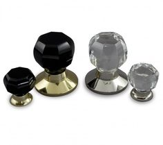Exclusive Designer Collection Octagonal Design Crystal Door & Cabinet Knobs  Door version shown with Black Crystal Knob and Plain Polished Brass Rose  Cabinet version shown with Black Crystal Knob and Mushroom design Polished Brass Rose