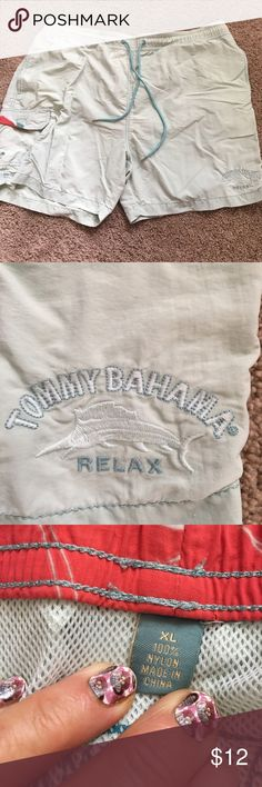 Tommy Bahama men's extra-large swimming trunks Tommy Bahama  men's extra-large swim trunks they were a darker green but I wash them and Oxy clean and now my husband is mad at won't wear them have two tiny spots in the back see photo otherwise faded but great condition Tommy Bahama Swim Swim Trunks