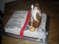 Lord of the Rings birthday cake - Used Wilton book cake tin, covered in fondant icing, writing with food colouring pen. First paragraph of the book on one page and the other page is a map of middle earth, Gandalf made from sponge and modeling icing, icing ring and icing Golum