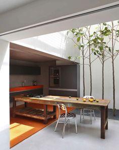 Orange Countertop in the Kitchen of Guillerme Torres in Brazil, Remodelista