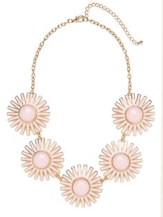This spectacular statement necklace works a sophisticated, ladified vibe. Just look at those audacious sunburst accents, crafted from cool graphic shapes.