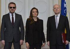 Angelina Jolie and William Hague (right) with the chairman of the Bosnian Presidency Bakir Izetbegovic (left), upon their arrival for a conference in Sarajevo, Bosnia