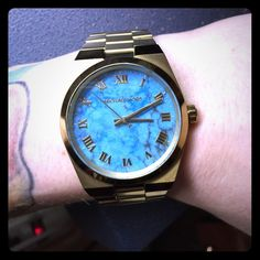 Michael Kors Turquoise Watch ✔️Authentic Michael Kors Watch. Turquoise face: Feat. Yellow Gold Roman numerals, minute marks, clock hands & MK name. All Stainless Steel. 251401 10 ATM. MK-5894. MK emblem on wind wheel. 2516000 stamped on inside clasp. Movement: Quartz. Case Size: 38mm. Case Thickness: 9mm. Dial: Semi Precious Turquoise. Crystal: Scratch Resistant Mineral. Band Width: 24mm Water Resistance:100meters (330ft)No TradesNo Low Ball/Unreasonable Offers.Don't expect me to reply to…