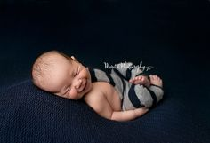 Baby Jonathan with huge smile, Photographed by Moretti  Photography. Ankeny / Des Moines, IA newborn Photographer