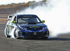 2006 Subaru Impreza WRX STI tuned by Crawford Performance is the First Gymkhana Car, has over 530 Wheel Horsepower delivering power to the Impreza's all wheel drive system. Ken Block behind the wheel of that 4 wheel burn out.