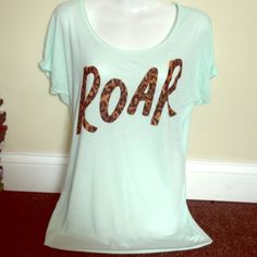 """VS Pink """"Roar"""" Tshirt Adorable VS Pink tee , in lift green color. Lightweight tee, size medium and can be worn off the shoulder. Worn once. Size medium Victoria's Secret Tops"""