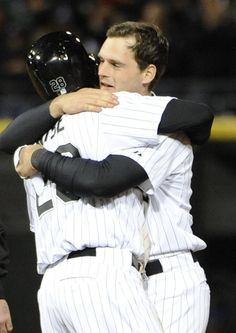 CHICAGO, IL -MAY 25: Conor Gillaspie #12 of the Chicago White Sox is greeted by Dewayne Wise #28 after hitting a walk-off game winning single against the Miami Marlins during the ninth inning on May 25, 2013 at U.S. Cellular Field in Chicago, Illinois. The Chicago White Sox defeated the Miami Marlins 2-1. (Photo by David Banks/Getty Images)