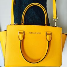 Michael Kors medium Selma brand new with tag. Saffiano leather. Color: Sun, price is firm Michael Kors Bags Crossbody Bags