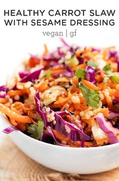 This healthy Carrot Slaw recipe uses cabbage and quinoa for an easy summer side. This quick vegan salad is tossed in a delicious, easy Asian sesame dressing. Perfect to use on fish tacos or as a side dish for your summer 4th of July BBQ! #healthyslaw #carrotslaw #sesamedressing #slawrecipes