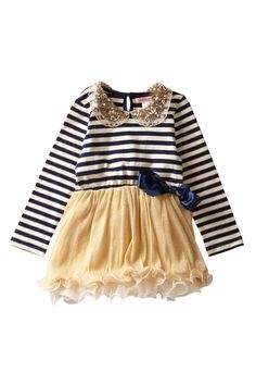 A sparkly collar, long sleeves to keep her warm, and a flouncy golden tutu skirt (runs short, above the knee) ensure that she is both comfortable and stylish when making her holiday appearances!  A detachable, silky bow on a pin can be placed anywhere on the dress.  Available in navy blue/ivory s...
