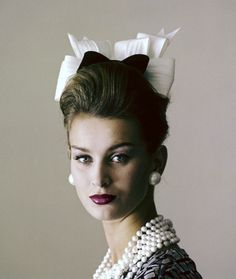 1960 Model Anna Carin is wearing a little hat of black velvet and starched white organdie bows by Adolfo for Emme, photo by Jerry Schatzberg for Vogue Feb.