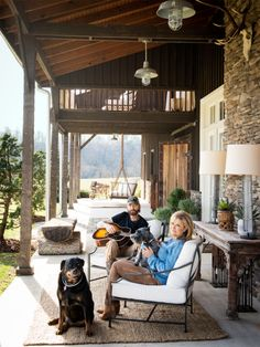 The plush furniture adds an inviting and warm feeling to the porch at Ronnie Dunn's Tennessee barn home.   - CountryLiving.com