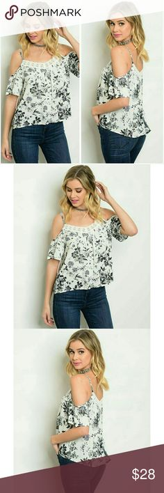 "Black & White floral cold shoulder blouse top NWT Pretty natural white and black floral cold shoulder top. Adjustable shoulder straps, pretty crochet trim at the front and back neckline, 22"" long from the shoulder to the bottom, 24"" in the back. 100% rayon, fabric is not sheer or see through. Ladies: Small 7/8 Bust 36"" Medium 9/10 Bust 38"" Large 11/12 Bust 40"" Tops Blouses"