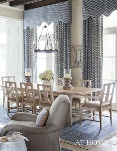 Beautiful dining room. Like the segue into living area starting with the armchair.